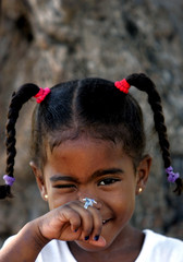 Little Cuban girl shows off her ring.
