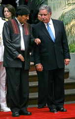 Bolivian president Evo Morales talks with Guatemalan president Oscar Berger during a welcoming ceremony in Guatemala City