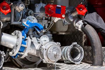 valves, pressure gauges and hoses on rear of fire engine