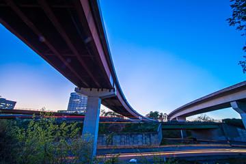 night traffic with light trails on highway interchange