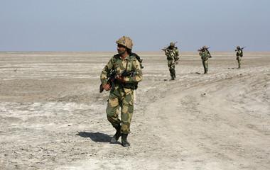 India's BSF soldiers patrol near international border with Pakistan at Sir Creek