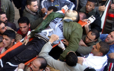 Palestinians carry the body of a militant killed by Israeli troops in Nablus
