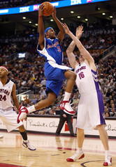 Toronto Raptors Ewing gets up over Los Angeles Clippers Bonner during their NBA game in Toronto