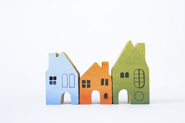 Colorful wooden miniature house on white background, real estate concept