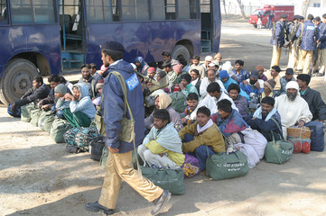 A goup of Indian fishermen sit at Wagah border near Lahore.