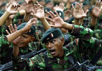INDONESIAN SOLDIERS FROM THE NEWLY FORMED ELITE RAIDERS SING PATRIOTIC SONGS IN JAKARTA.