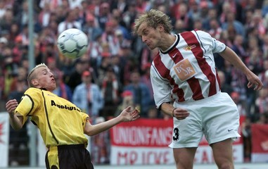 THURK OF FSV MAINZ 05 FIGHTS FOR THE BALL WITH NIKOL OF FC UNION BERLINDURING THEIR SECOND LEAGUE ...