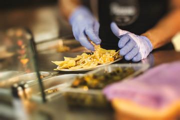 Chef preparing nachos in food truck