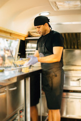 Man cooking in food truck