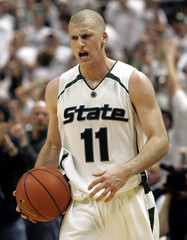 Michigan State's  guard Drew Neitzel starts to celebrate victory over Wisconsin Badgers in East Lansing