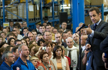 France's President Sarkozy delivers a speech at Poclain Hydraulics enterprise in Northern France