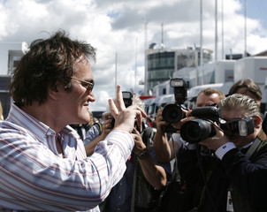 US director Tarantino flashes victory sign before the European Formula One Grand Prix at the Nuerburgring racing circuit in western Germany
