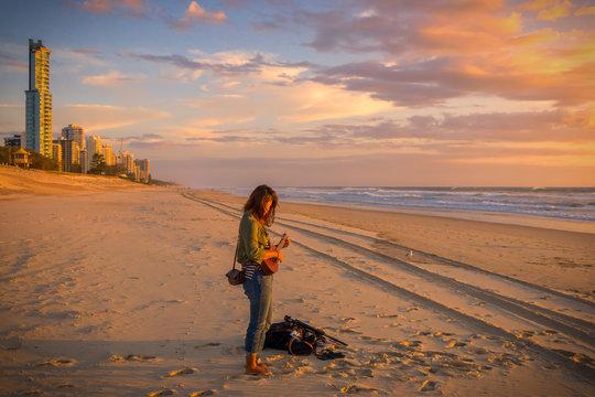 A Girl Playing Ukuele On The Beach