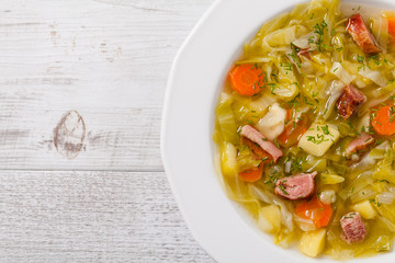 Homemade cabbage soup, cooked on smoked ribs.