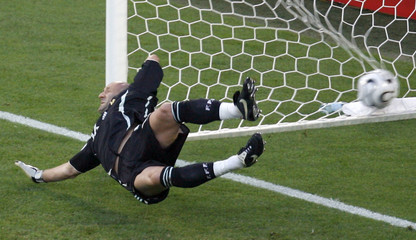France's goalkeeper Barthez dives for the ball as Spain's Villa scores his team's first goal against France during their second round World Cup 2006 soccer match in Hanover