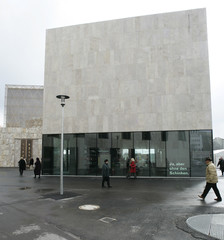 People walk in front of the new Jewish museum in Munich one day before its opening for the public