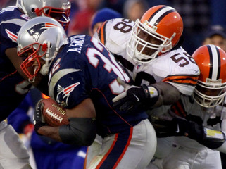 PATRIOTS ANTOWAIN SMITH CHASED BY BROWNS RAINER AND BUSH.