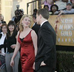 Actresses Virginia Madsen and Leonardo DiCaprio arrive during the 11th annual Screen Actors Guild awards.