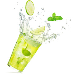 lime and mint falling into a splashing mojito