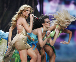 Gheorghe of Romania performs during the first semi-final of the Eurovision Song Contest in Moscow