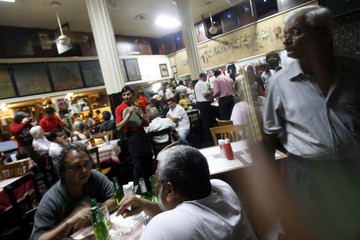 People eat at Cafe Leopold after it re-opened after recent militant attacks in Mumbai
