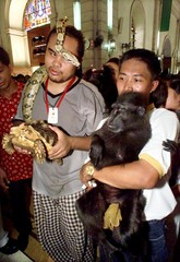 FILIPINO PET OWNERS WAIT FOR A PRIEST TO BLESS THEIR ANIMALS IN MANILA.