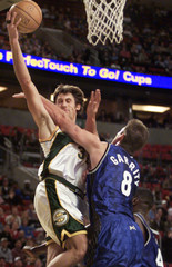ORLANDO MAGIC FORWARD PAT GARRITY FOULS SEATTLE SUPERSONICS GUARD BRENTBARRY.