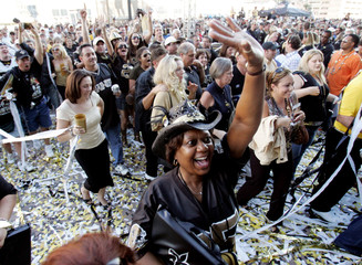 New Orleans Saints fans party outside the Louisiana Superdome before their team takes on the Atlanta Falcons in New Orleans