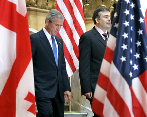 US President Bush and Georgian President arrive for joint news conference at Georgian Parliament in ...