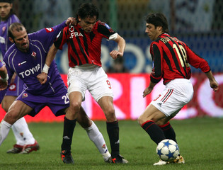 AC Milan's Inzaghi challenges Pancaro of Fiorentina during Italian Serie A soccer match in Milan