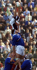 ITALY'S ANDREA GRITTI AND DAVID ARADOU OF FRANCE JUMP FOR THE BALL IN ROME.