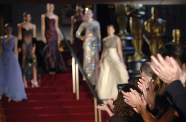 "Audience members applaud at the conclusion of ""A Celebration of Oscar Fashions"" in Beverly Hills"