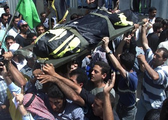 PALESTINIANS CARRY ONE OF THREE KILLLED PALESTINIANS DURING THE FUNERAL IN JENIN.