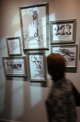 A woman looks at cartoons at the Lincoln museum in Springfield Illinois