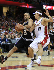 Spurs Parker drives to the basket while defended by Cavaliers West during the second quarter of their NBA basketball game in Cleveland