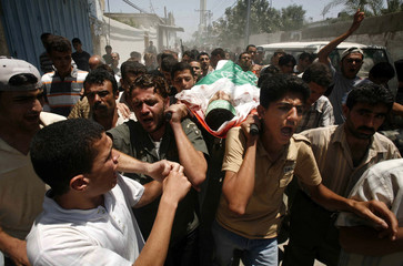 Palestinians carry the body of al-Abadli after he was killed by Israeli troops in Gaza