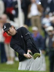 Henry of U.S. plays from rough on 10th hole during American Express Championship golf tournament in Watford