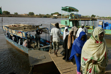 Sudanese villagers disembark from a canoe on the banks of river Nile in Sudan's capital Khartoum.