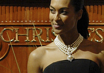 A model displays a natural pearl and diamond necklace as it is auctioned during a jewellery sale by Christie's in Dubai