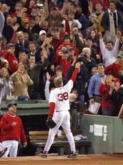 Boston Red Sox pitcher Schilling tips his hat to crowd while playing Cleveland Indians during sixth inning in Boston