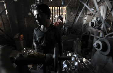 Khalil,12, works in an aluminium factory in Dhaka