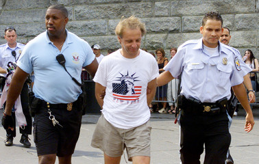 FRENCH STUNTMAN TERRY DO LED AWAY FROM STATUE OF LIBERTY BY POLICE.
