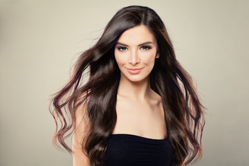 Young Hispanic Fashion Model Woman with Brown Blowing Hair and Perfect Makeup