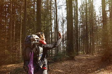 Woman taking a selfie on a hike through the woods