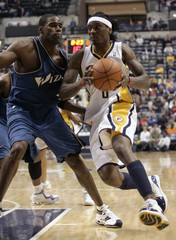 ndiana Pacers' Marquis Daniels drives on Washington Wizards' Antawn Jamison in Indianapolis