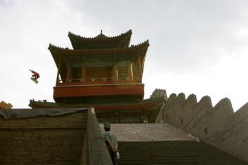 Way of US jumps over Great Wall of China on skateboard at historical Ju Yong Guan Gate.