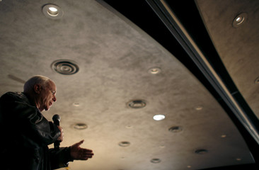 John McCain speaks during a town hall meeting in Iowa