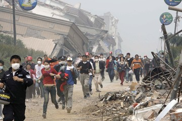Residents and rescue workers evacuate from the centre of earthquake-hit Beichuan county