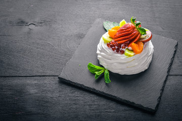 Desart with fresh strawberries and mint. Italian cuisine. Top view. On Wooden background.