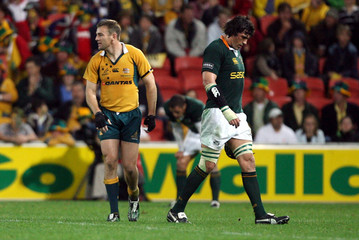 South Africa's Matfield walks past Australia's Latham after Matfield was sent off during a Tri-Nations rugby union match in Brisbane